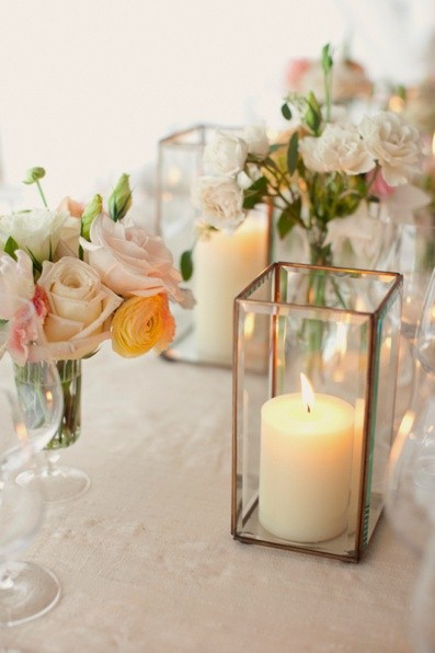 classic pillar candles and mixed flowers