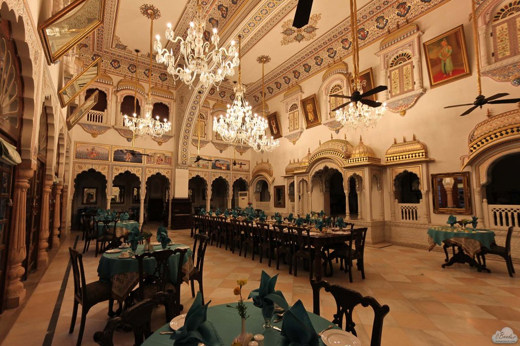 Awe inspiring dining hall of Alsisar Mahal. Gold-leaf work all over along with flawless miniature paintings.